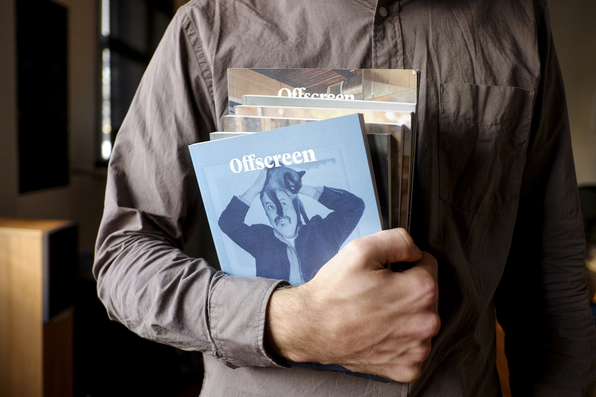 Kai Brach holding issues of the Offscreen Magazine